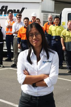 Female engineer working at Interflow. Staff group shot.