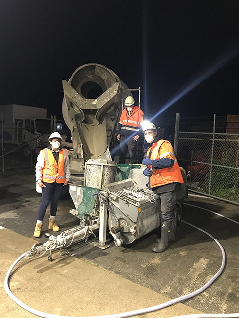 Female engineer and two field crew members work on critical infrastructure project