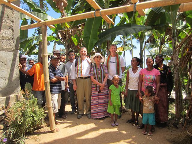 Interflow Managing Director, Geoff Weaver, and Water Aid volunteers in rural community in Timor-Leste