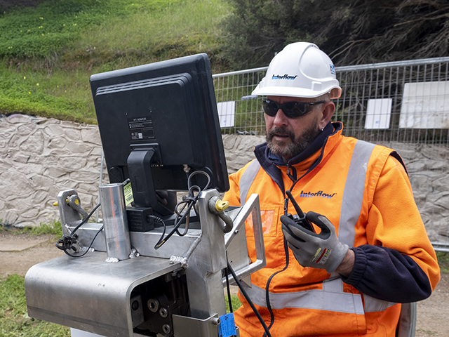 nterflow employee operates remote Rotaloc machine from a safe distance