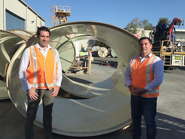 Interflow employees stand next to innovative stormwater solution